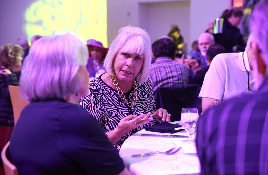Ruth Motta, right, and Paula Anderson, 74, both of Las Vegas, during Death Over Dinner - Alzhei ...