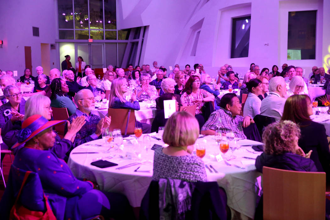 Guests applaud during Death Over Dinner - Alzheimer's Edition in the Keep Memory Alive Event Ce ...