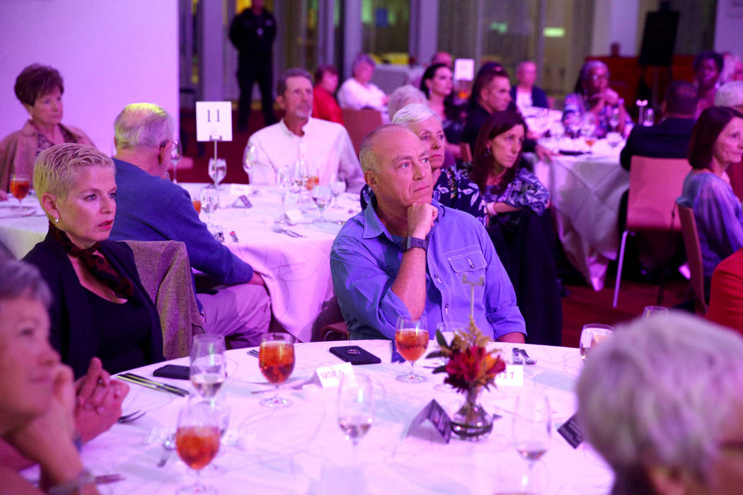 Guests, including Nora Kraidman and her husband Amit Kraidman, of Las Vegas, listen during Deat ...
