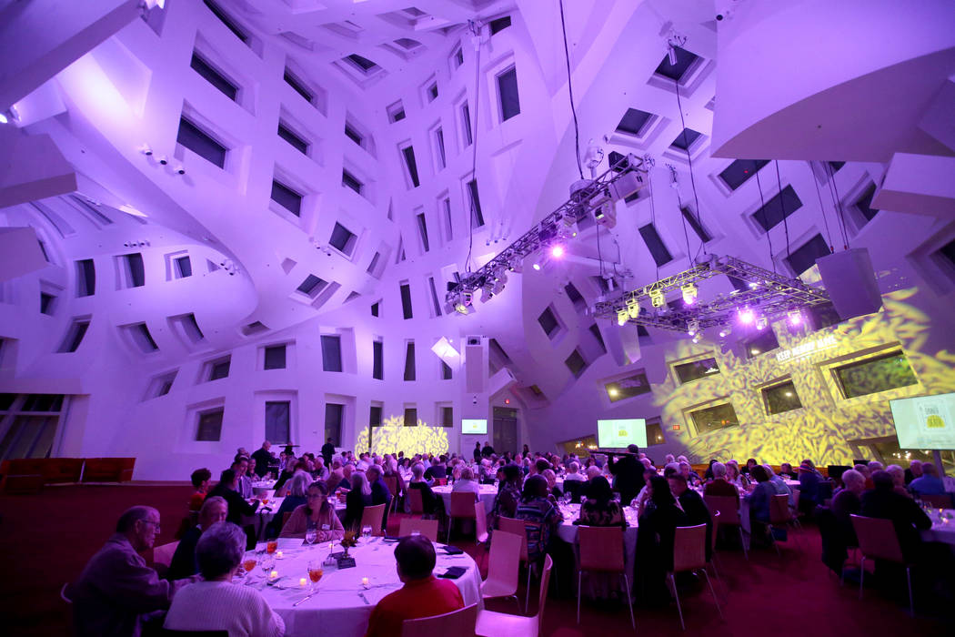 Guests talk during Death Over Dinner - Alzheimer's Edition in the Keep Memory Alive Event Cente ...