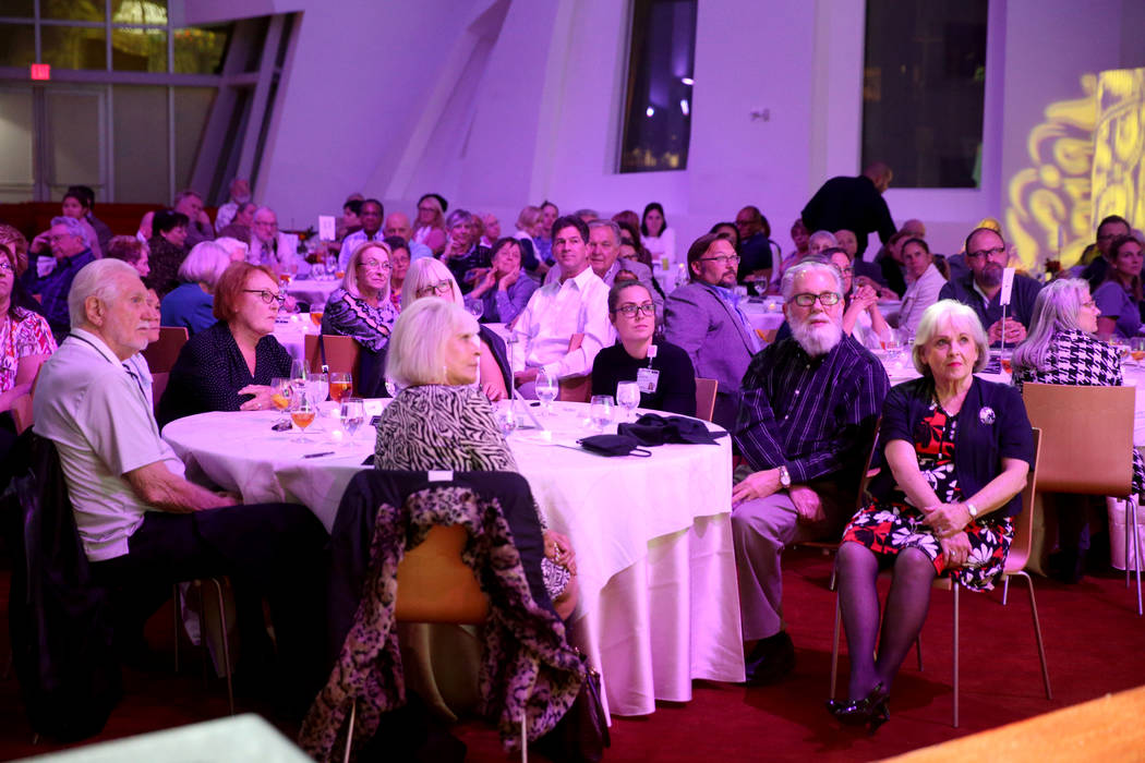 Guests listen during Death Over Dinner - Alzheimer's Edition in the Keep Memory Alive Event Cen ...