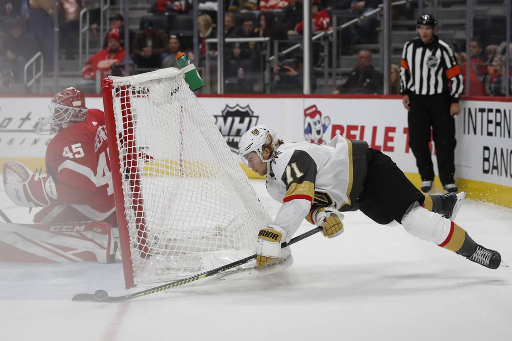 Vegas Golden Knights center William Karlsson (71) attempts a shot on Detroit Red Wings goaltend ...