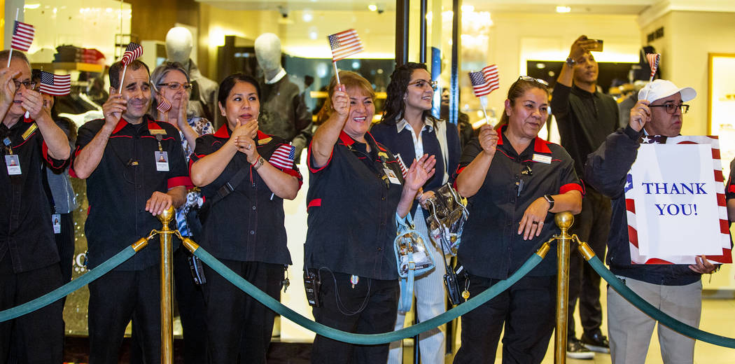 Employees from The Venetian gather to applaud as wounded veteran's and family members enter the ...