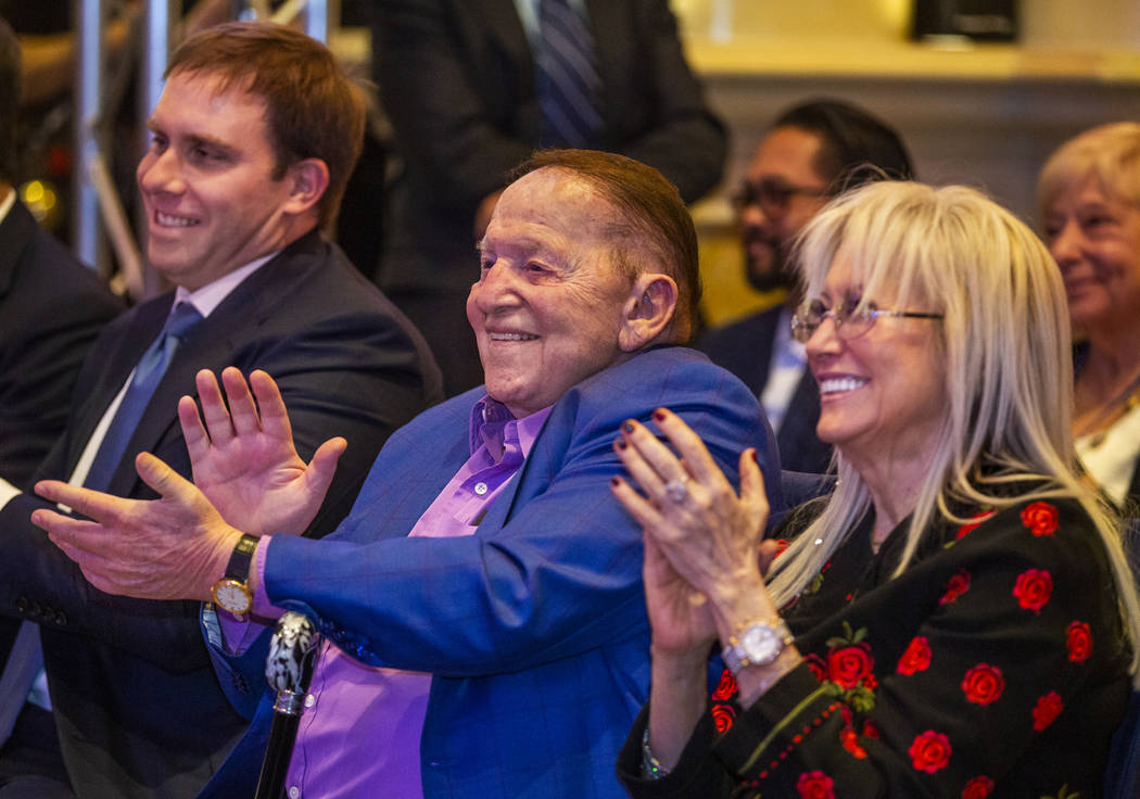 Las Vegas Sands Chairman and CEO Sheldon Adelson and his wife Miriam applaud Gov. Steve Sisolak ...