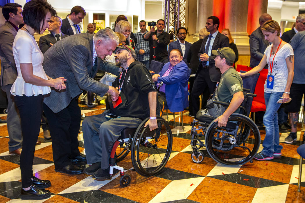 Gov. Steve Sisolak with his wife Kathy with Sheldon and Miriam Adelson thank wounded veterans a ...