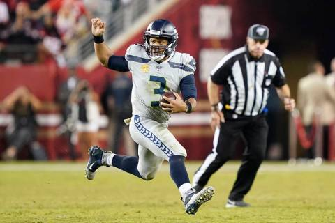 Seattle Seahawks quarterback Russell Wilson (3) runs the ball against the San Francisco 49ers d ...