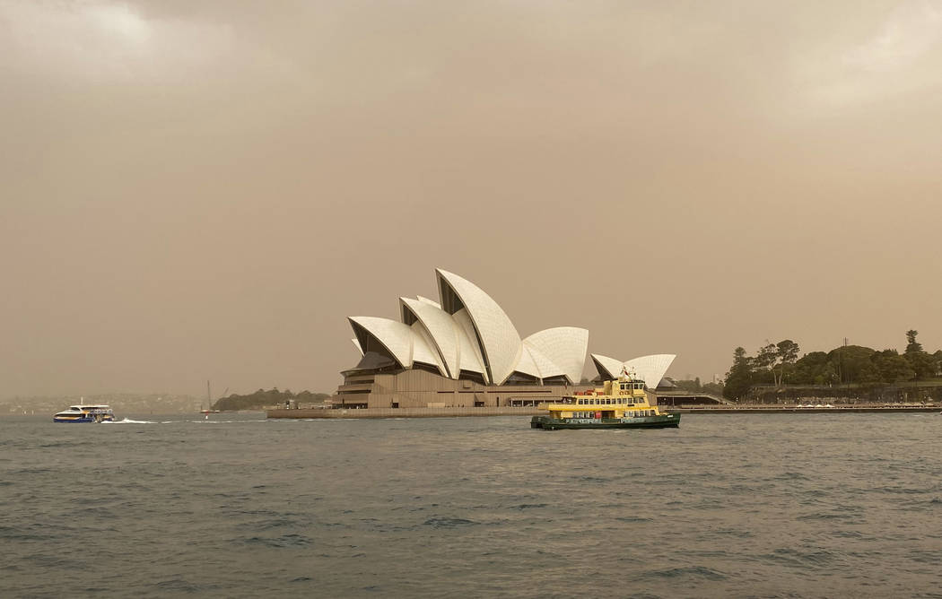 Sydney Opera House is backdropped by haze from wildfires near the city, in Sydney, Australia, T ...