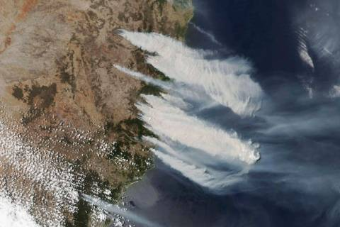 This Nov. 8, 2019, satellite photo taken by NASA shows hot, dry and windy weather conditions as ...