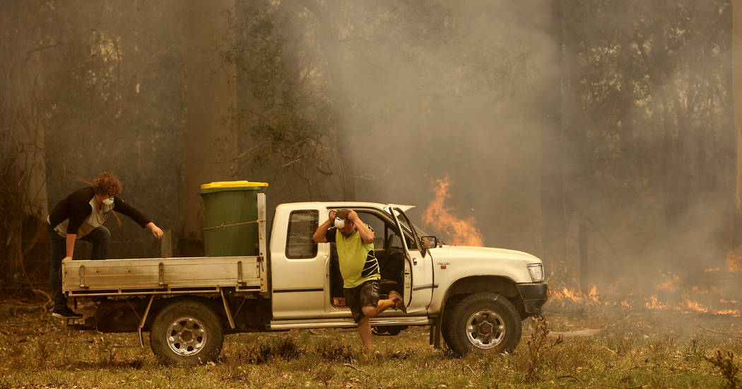 Jamie Fato prepares to stop an out of control fire entering Owen Whalan's property at Kooraingh ...
