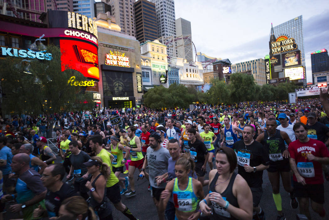 Participants head out from the start line outside of the New York-New York at the beginning of ...
