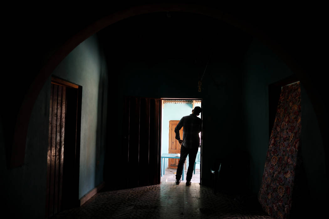In this Aug. 23, 2019, photo, a Honduran father stands at his home in Comayagua, Honduras, afte ...