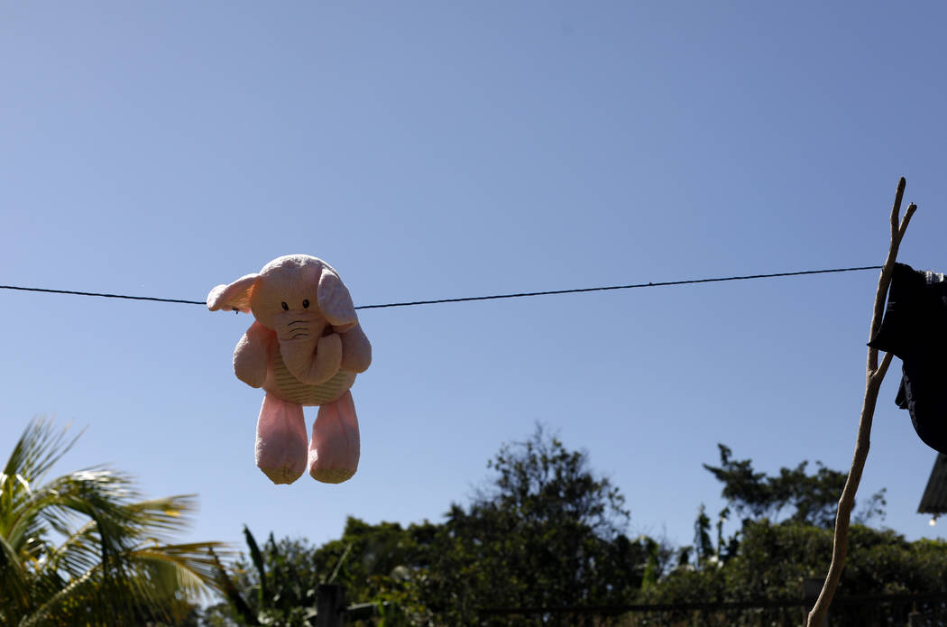This Aug. 23, 2019, photo shows a stuffed animal hanging to dry at the Comayagua, Honduran home ...