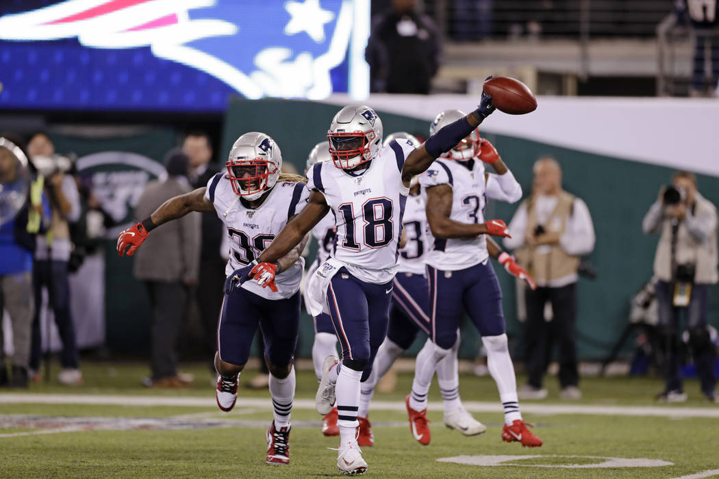 New England Patriots' Matthew Slater (18) celebrates with teammates during the second half of a ...