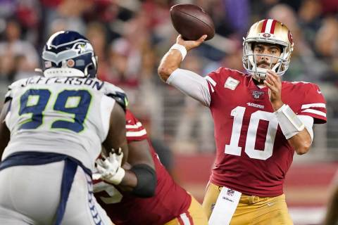 San Francisco 49ers quarterback Jimmy Garoppolo (10) passes against Seattle Seahawks defensive ...