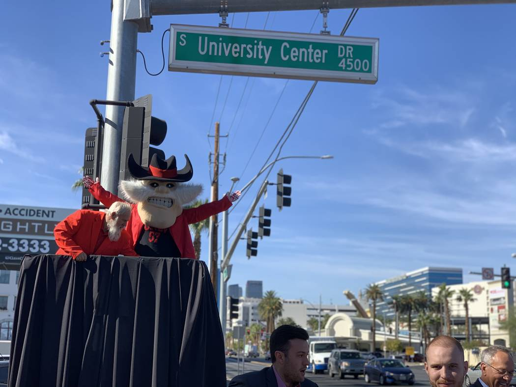 UNLV mascot Hey Reb unveils the first University Center Drive street sign on the southeast corn ...