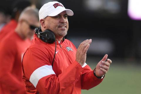 UNLV Head Coach Tony Sanchez encourages his team against Vanderbilt in the second half of an NC ...