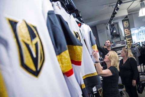 Charmaine Pennington, left, shops for Golden Knights jerseys on Wednesday, April 18, 2018, at T ...