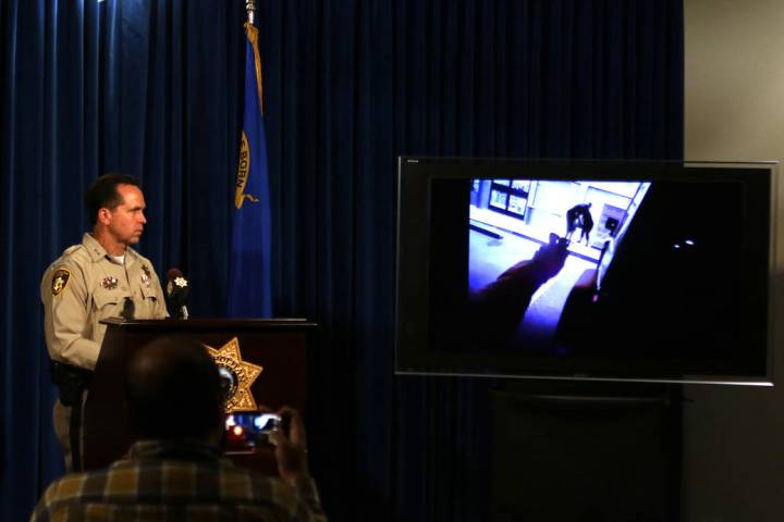 Las Vegas Metropolitan Police Department Assistant Sheriff Tom Roberts watches footage from a b ...