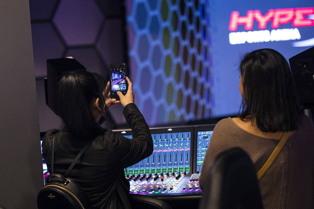 Grant recipient Obe Wan takes a picture while exploring the production room during a visit to t ...