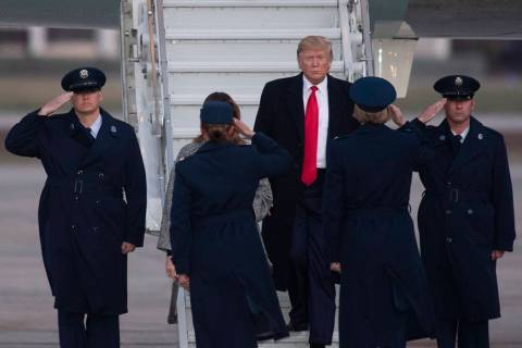 President Donald Trump walks from Air Force One on Tuesday, Nov. 12, 2019, at Andrews Air Force ...