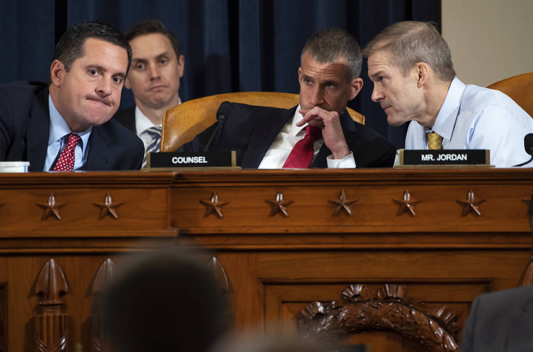 Ranking member Rep. Devin Nunes, R-Calif., left, confers with Rep. Jim Jordan, R-Ohio, right, a ...