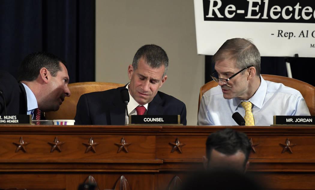 Ranking member Rep. Devin Nunes, R-Calif., left, talks to Rep. Jim Jordan, R-Ohio, right, as St ...