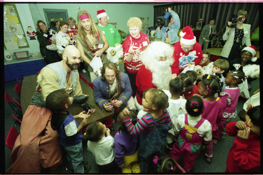 Santa Claus, Mrs. Claus and pirates from Treasure Island show deliver about 200 stuffed animals ...