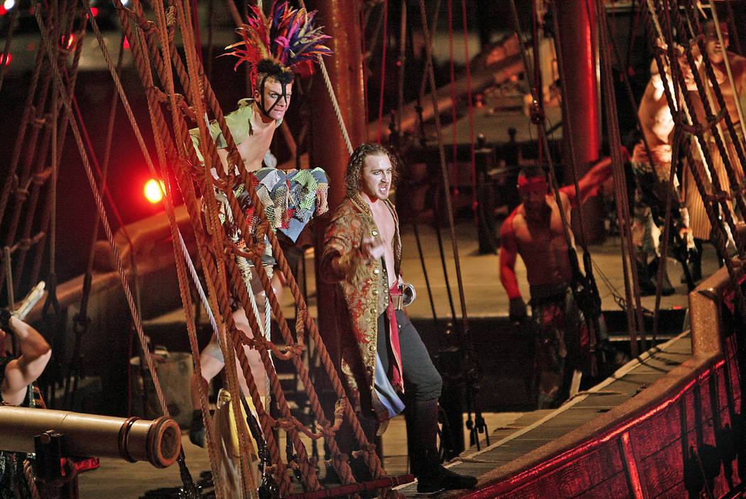 Pirates Nicholas Baker, left, and Rhett Noseck prepare to board the sirens' ship in a performan ...