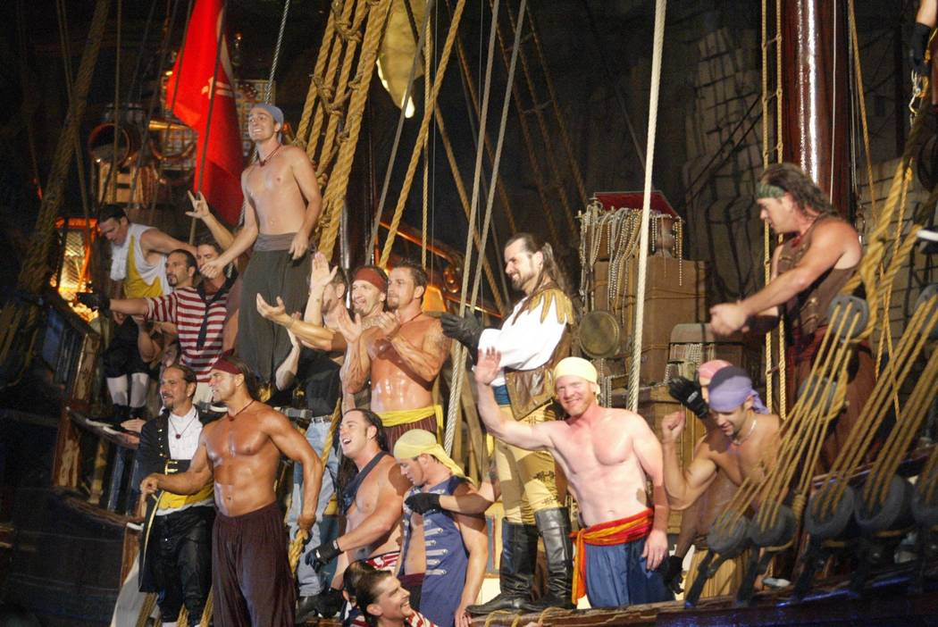 """""""Battle of Buccaneer Bay"""" cast members take a bow from their ship during their last show on Jul ..."""
