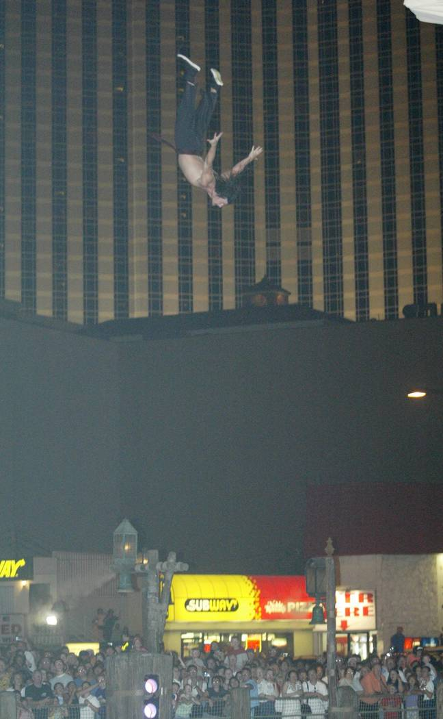 """A """"Battle of Buccaneer Bay"""" cast member takes a high dive from the mast of his ship during the ..."""