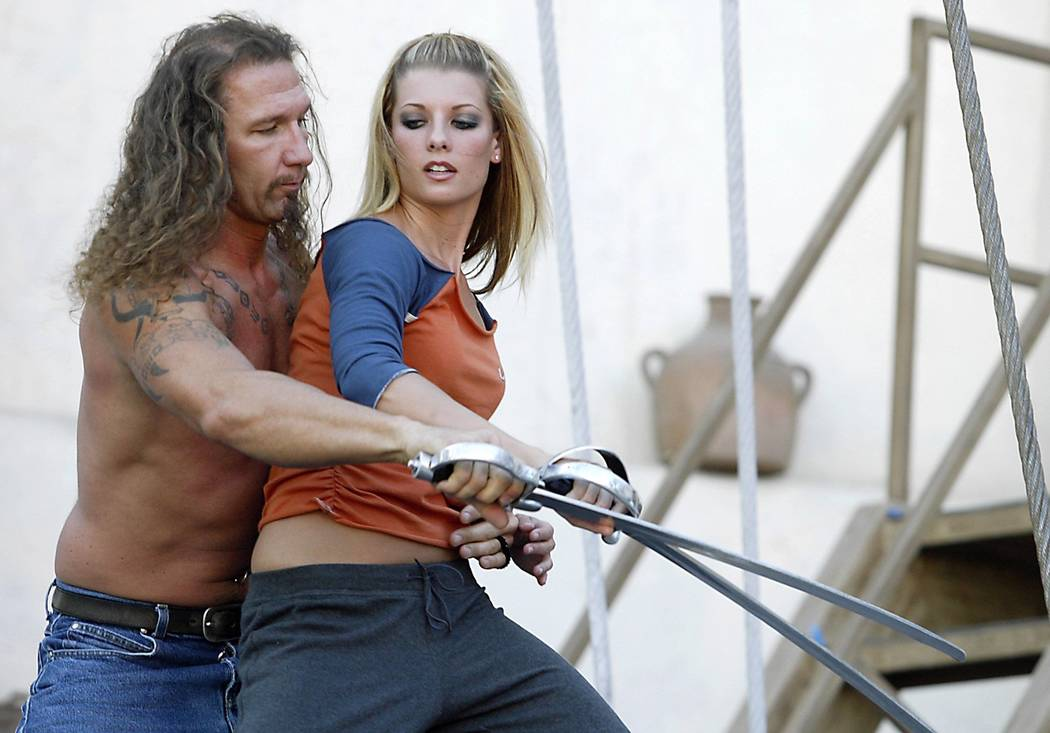 Siren Nicci Abram fights off pirate Patrick Watson during rehearsal as they prepare for the upd ...