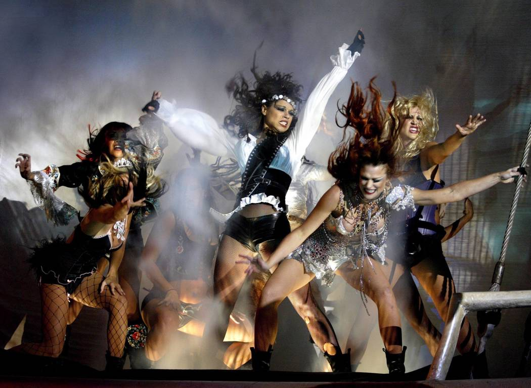 """Sirens react after pirates fire on their ship during an October 2003 """"Sirens of TI"""" show. (Las ..."""
