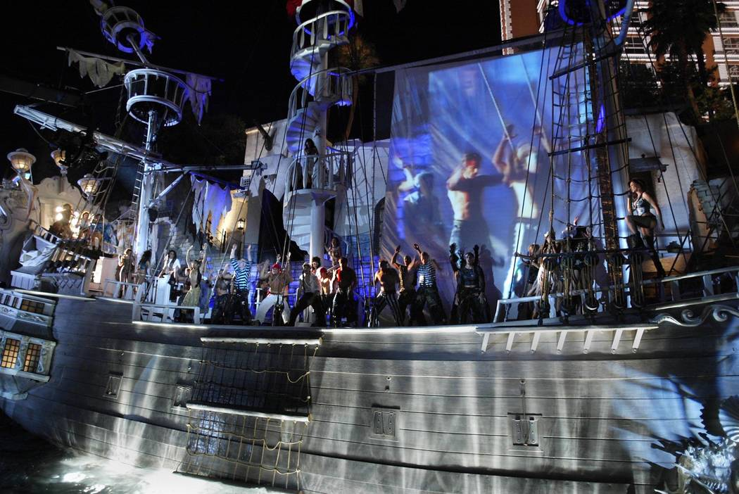 """Sirens and pirates sing and dance aboard the sirens' ship during """"Sirens of TI."""" (Las Vegas Rev ..."""