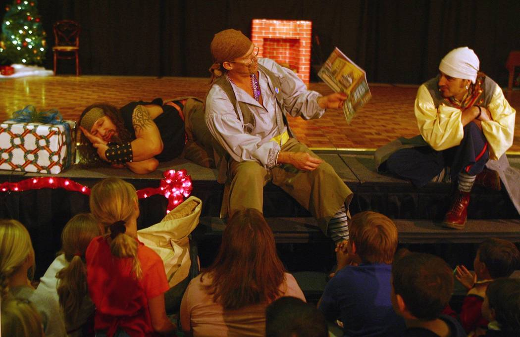 """Pirates from """"Battle of Buccaneer Bay"""" read a Christmas story at a Nov. 29, 2002 holiday festiv ..."""