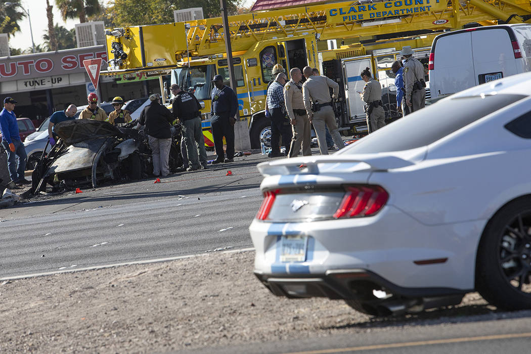The Las Vegas Fire Department works to evacuate a vehicle involved in a suspected DUI crash on ...