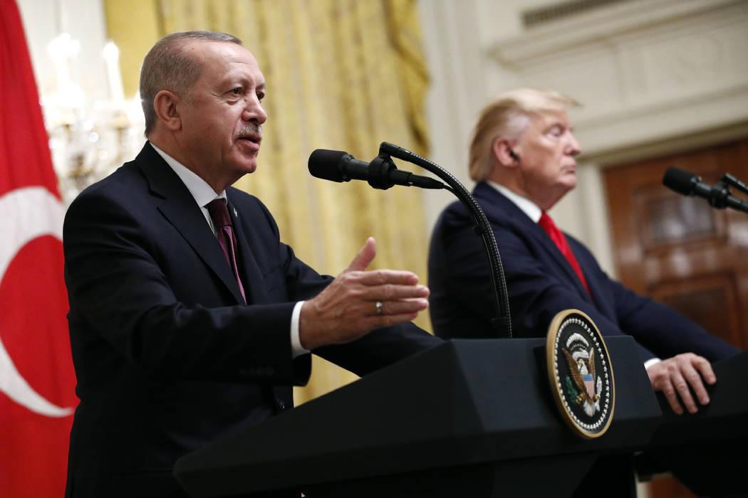 Turkish President Recep Tayyip Erdogan speaks at a news conference alongside President Donald T ...