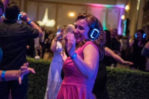 A woman dances in the silent disco during the UNLVino fundraiser at the Paris hotel-casino in L ...
