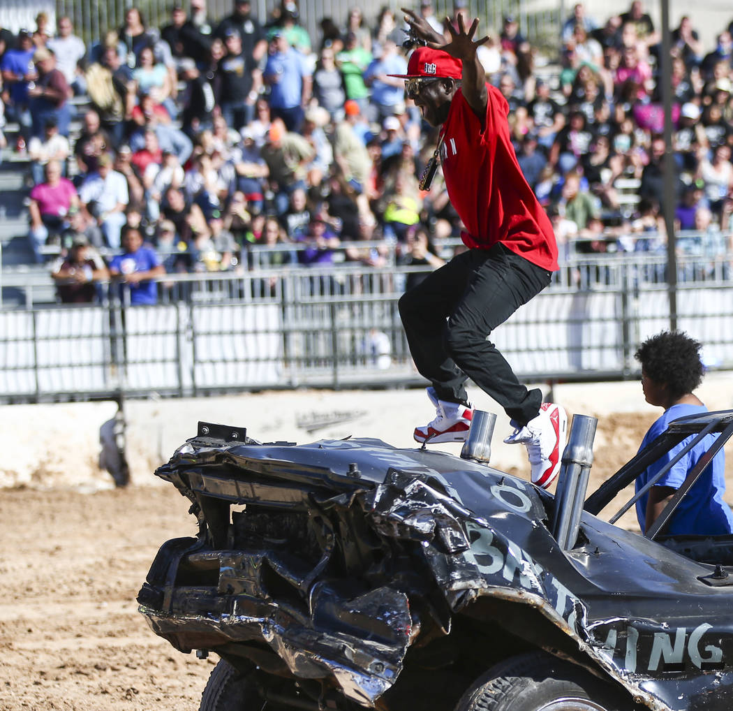 Flavor Flav jumps off a derby car during the inaugural Casino Battle Royale Demolition Derby at ...