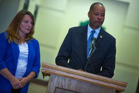 Nevada Attorney General Aaron Ford, right, speaks with Clark County Commissioner Marilyn Kirkpa ...