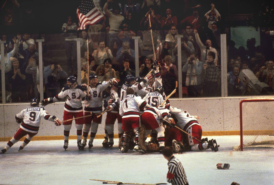 FILE - In this Feb. 22, 1980, file photo, the U.S. hockey team pounces on goalie Jim Craig afte ...