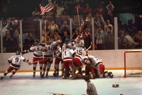 The U.S. hockey team pounces on goalie Jim Craig after a 4-3 victory against the Soviets in the ...