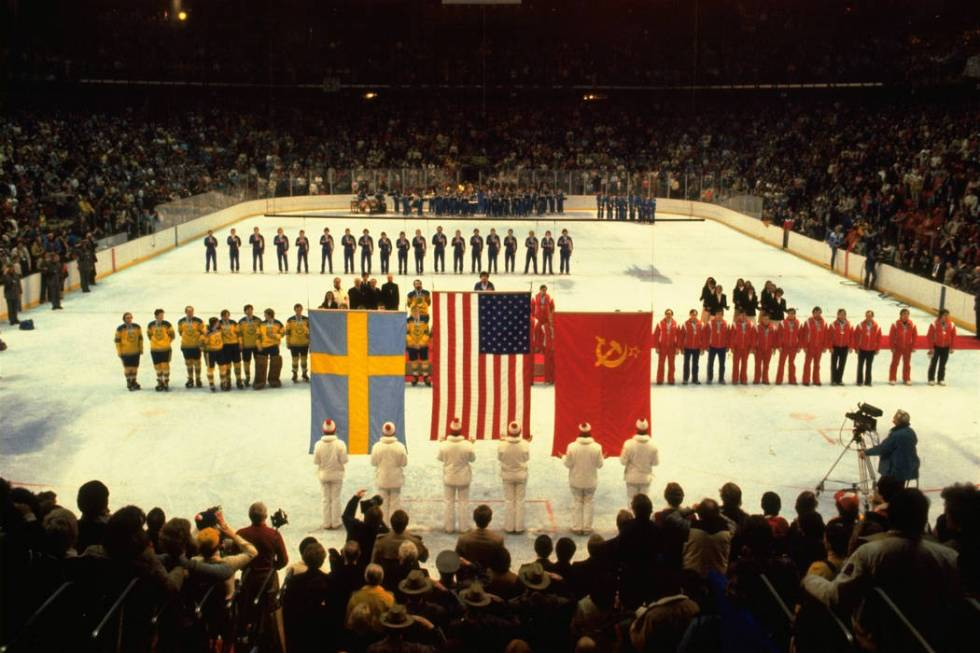 U.S., Swedish, and Soviet teams line up to receive their Olympic gold, bronze, and silver medal ...