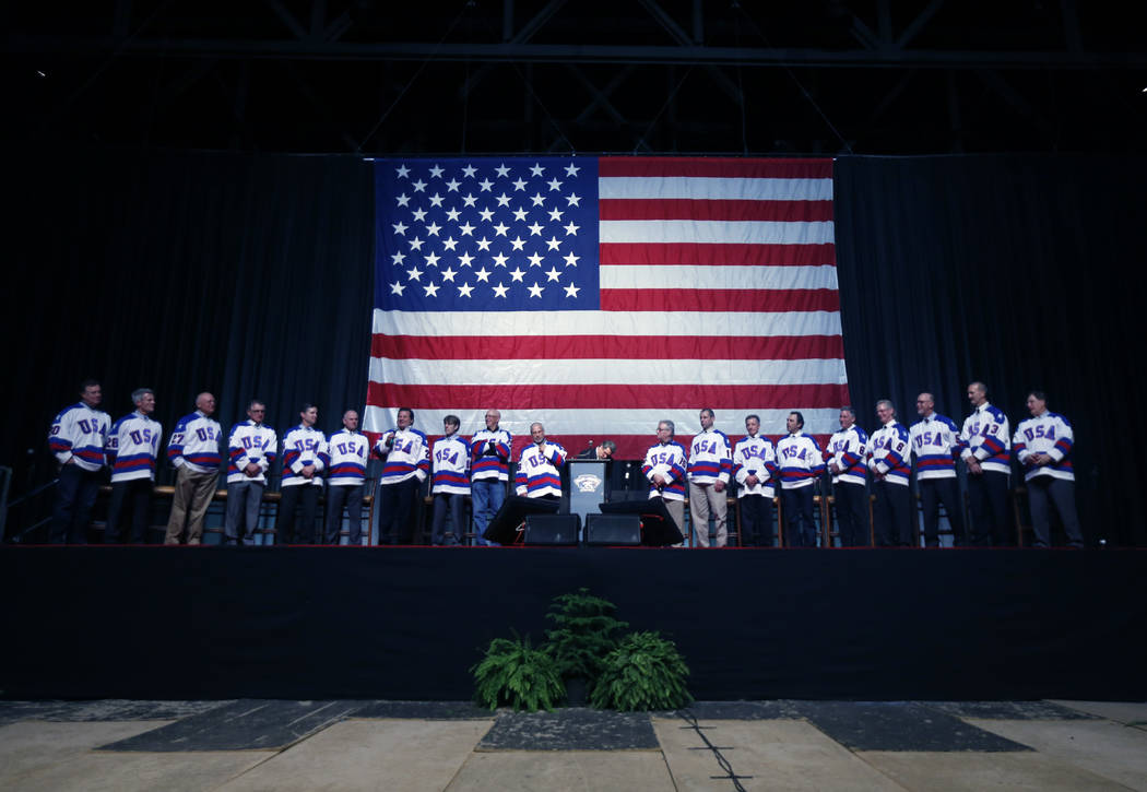 "Members of the 1980 U.S. ice hockey team stand on stage during a ""Relive the Miracle"" ..."