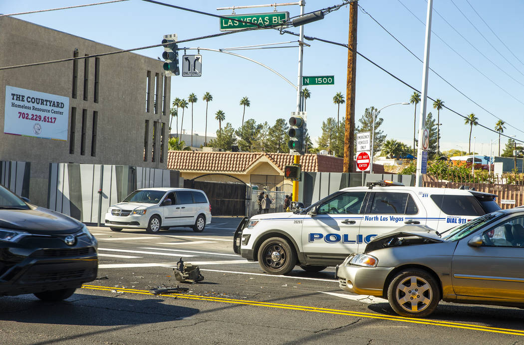 North Las Vegas police investigate an accident near the recently installed gate at Foremaster L ...