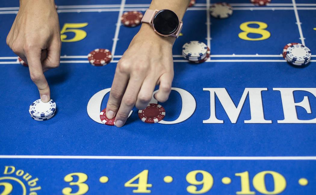 Jelena Dobras practices dealing craps at the CEG Dealer School in Las Vegas, Wednesday, Oct. 30 ...