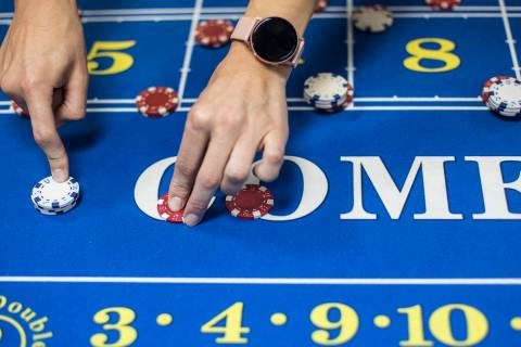 Jelena Dobras practices dealing craps at the CEG Dealer School in Las Vegas, Wednesday, Oct. 30 ...