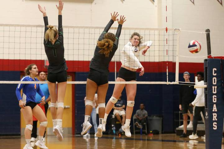Bishop Gorman's Tommi Stockham (3) connects with the ball for a point against Palo Verde during ...