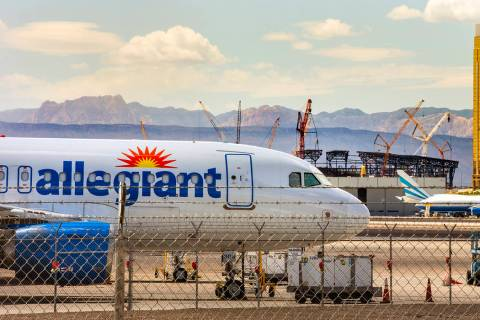 A Las Vegas-based Allegiant Air plane sits on the tarmac at McCarran International Airport with ...