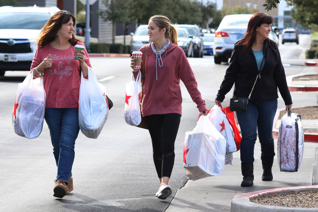 Gina Jackson, left, her daughter Haley and Angie Boschetto leave Macy's store after shopping du ...