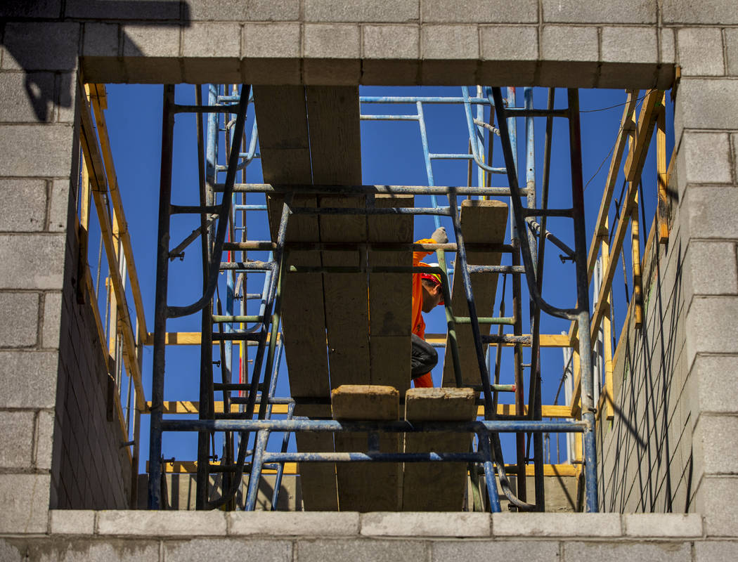 More scaffold is erected on a new apartment complex by developer Jonathan Fore currently under ...